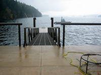 Hollow Core Concrete deck and epoxy painted aluminum ramp & handrail